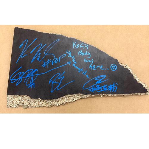 Photo of Extreme Rules USED section of table SIGNED by Shinsuke Nakamura, Cesaro, Big E and Kofi Kingston
