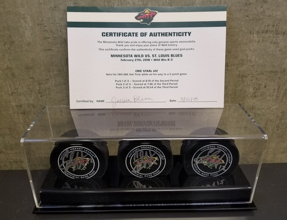 Wild Game Used Goal Puck-Staal 14th Career Hat Trick, 5 Point Game