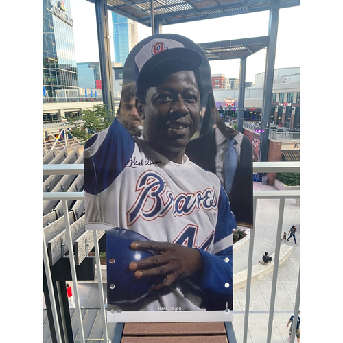 Photo of MLB Authenticated Autographed Cardboard Cutout photo of Hank Aaron becoming baseball's all-time home run king, hitting number 715 to move ahead of Babe Ruth on April 8th, 1974.
