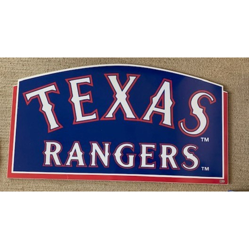 Photo of Metal Texas Rangers Sign Displayed in Equipment Storage Room in Home Vlubhouse at Globe Life Park