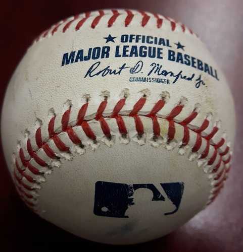 Photo of Authenticated Game Used Baseball - 1st Out Recorded in James Paxton's No Hitter Game on May 8, 2018. Dee Gordon grounds out to 2nd Base against Marcus Stroman (Top 1).