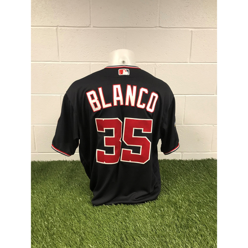 Photo of Game-Used Henry Blanco 2019 Navy Script Jersey with Postseason Patch