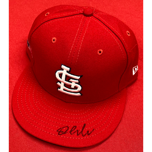 Photo of Dylan Carlson Autographed Team-Issued Home Cap (Size 7 3/4)