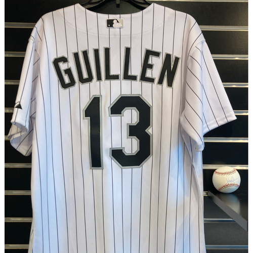 Photo of Ozzie Guillen 2009 Team Issued Jersey and Autographed World Series Baseball - Size 44 (Jersey not authenticated)