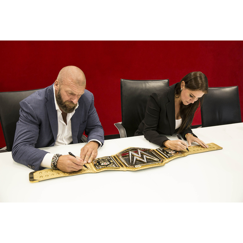 Connor's Cure WWE Championship Replica Title autographed by Stephanie McMahon & Triple H
