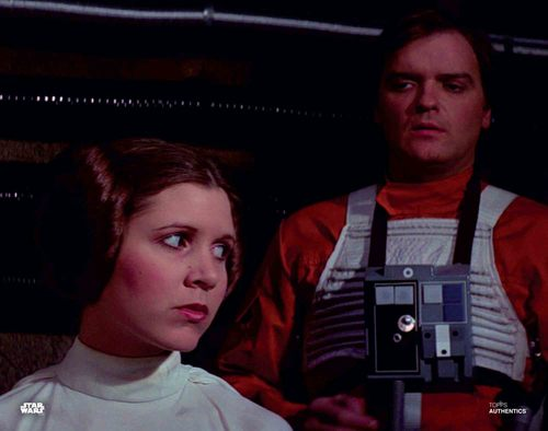 Carrie Fisher and Angus MacInnes as Princess Leia Organa and Gold Leader