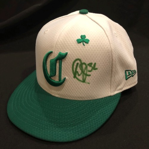 Photo of Derek Johnson -- Autographed & Game-Used Cap -- 2019 St. Patrick's Day