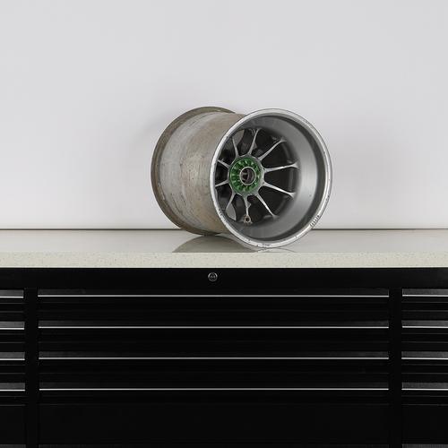 Photo of Sahara Force India F1 Team 2013 Race Used Green Wheel Nut Wheel Rim Table