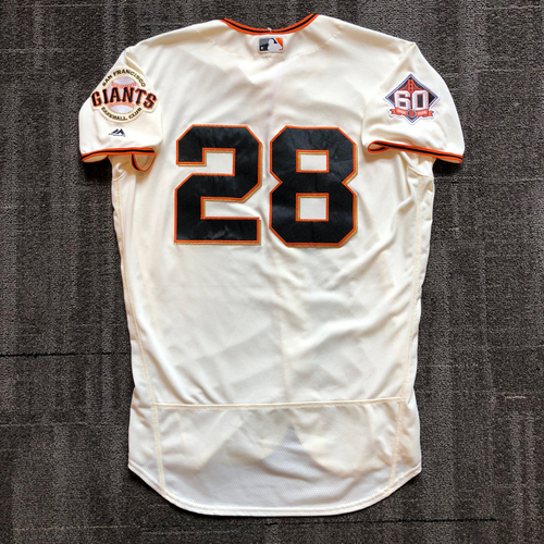 Photo of 2018 San Francisco Giants - Home Cream Game Used Jersey worn by #28 Buster Posey on 7/15/18 vs. Oakland Athletics & 7/29/18 vs. Milwaukee Brewers - Size 46
