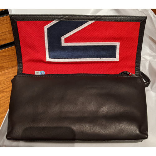 Photo of Tokens And Icons Game Used Jersey Purse