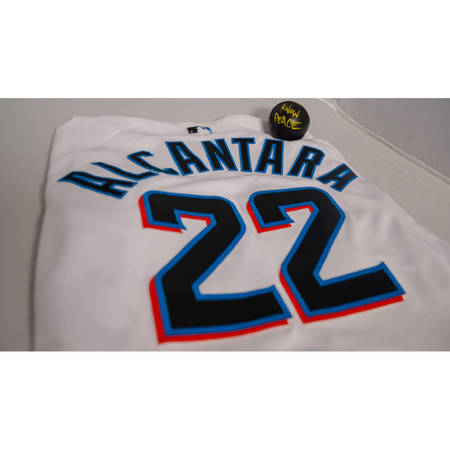 """Photo of Sandy Alcantara Game-Used Jersey with Specialty """"Know Peace"""" Baseball Designed by Sergio j. Quinonez - @illsurge - Jersey Size 46"""