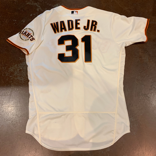 Photo of 2021 Game Used Home Cream Jersey worn by #31 LaMonte Wade Jr. on 4/11 vs. COL - 2-3, 2B, BB & 4/12 vs. CIN - PH-RF - Size 46