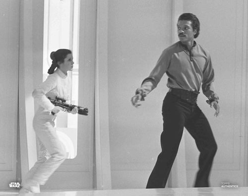 Carrie Fisher and Billy Dee Williams as Princess Leia Organa and Lando Calrissian