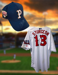 Photo of Cole Sturgeon Signed Jersey & Hat