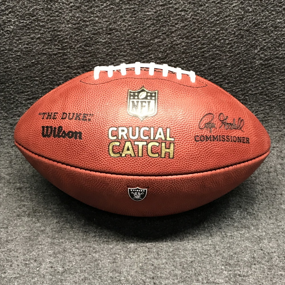 CRUCIAL CATCH - RAIDERS GAME READY FOOTBALL W/ CRUCIAL CATCH LOGO AND RAIDERS LOGO (OCTOBER 2017)