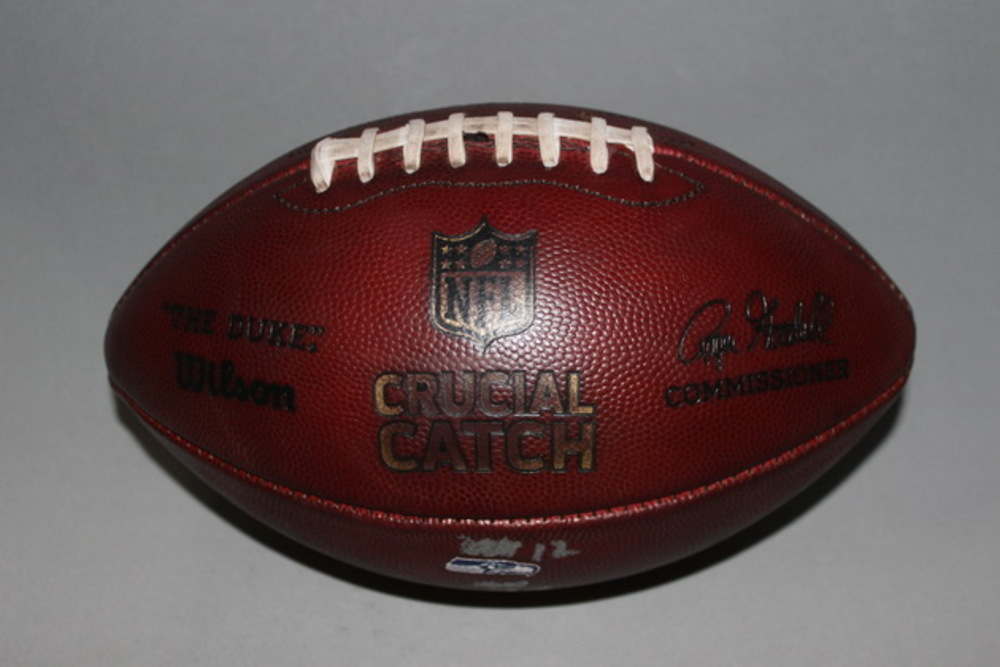 CRUCIAL CATCH - SEAHAWKS GAME USED FOOTBALL W/ CRUCIAL CATCH LOGO AND TEAM LOGO (OCTOBER 29, 2017)