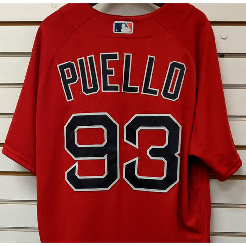 Photo of Cesar Puello #93 Team Issued Nike Red Spring Training Jersey
