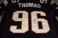 PATRIOTS - ADALIUS THOMAS SIGNED AUTHENTIC PATRIOTS REEBOK JERSEY - SIZE 48 (SPOTS ON JERSEY NUMBERS)