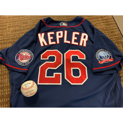 Photo of Max Kepler Team-Issued Jersey and Game-Used Baseball