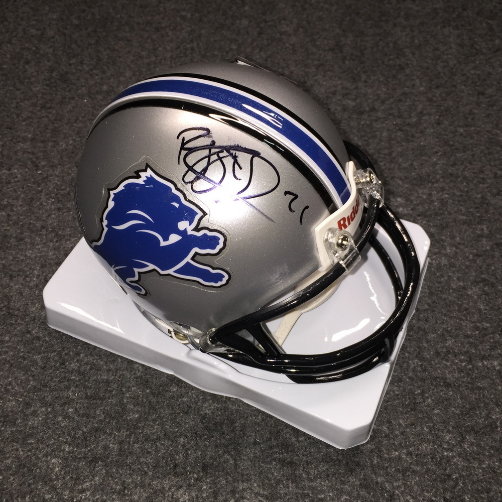 Lions - Reggie Bush signed lions mini helmet (smeared signature)