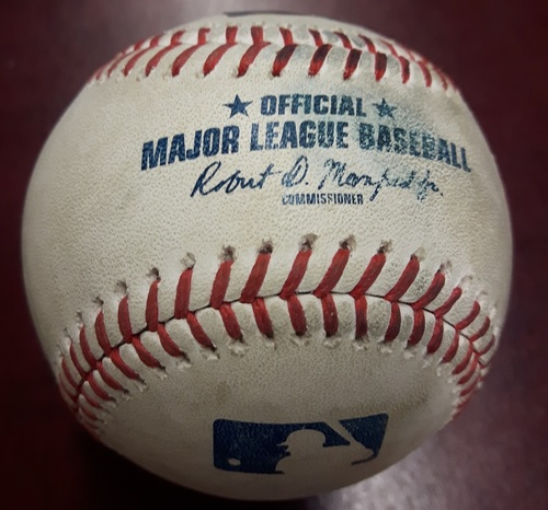 Photo of Authenticated Player Collected Baseball - Home Run by Devon Travis (2) against Tyler Skaggs. Bottom 3. May 23, 2018.