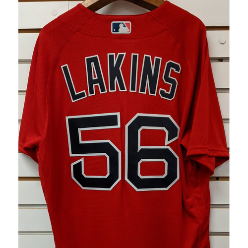 Photo of Travis Lakins #56 Team Issued Nike Red Spring Training Jersey