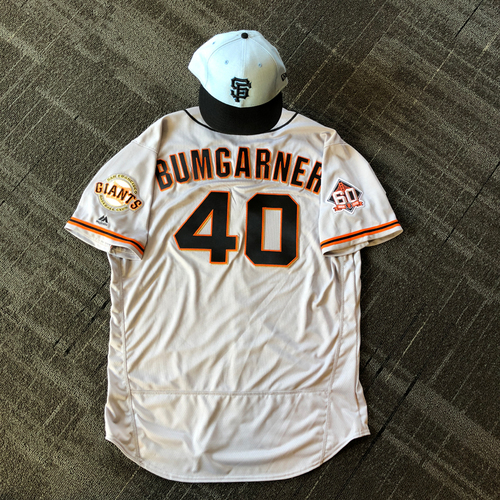 Photo of San Francisco Giants - Game Used Father's Day Blue Ribbon Jersey + Cap - #40 Madison Bumgarner (size 50 - cap 7 3/8)
