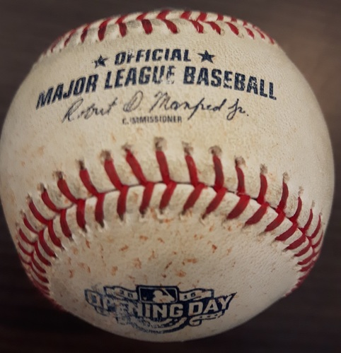 Photo of Authenticated Game Used Baseball - Pitch in the dirt from Jake Odorizzi to Dalton Pompey (April 13, 2015 vs Tampa Bay). Bottom 3. 2015 Blue Jays Home Opener.
