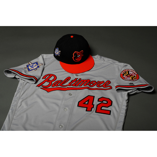 Photo of Adam Jones Autographed, Game-Worn Jackie Robinson Day #42 Jersey and Cap
