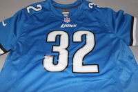 LIONS - TAVON WILSON SIGNED LIONS REPLICA JERSEY - SIZE L (STAIN ON FRONT OF JERSEY)
